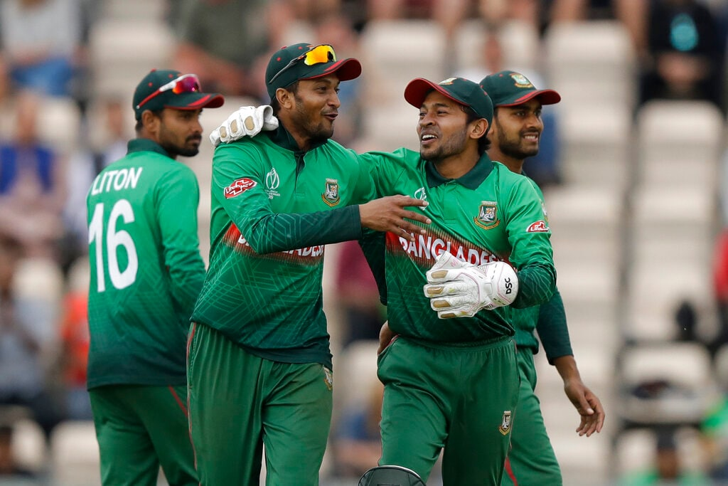 Bangladesh's Shakib Al Hasan, left, and Bangladesh's Mushfiqur Rahim celebrate after the wicket of Afghanistan's Rashid Khan fell during the Cricket World Cup match between Bangladesh and Afghanistan at the Hampshire Bowl in Southampton, England, Monday, June 24, 2019. (AP Photo/Matt Dunham)