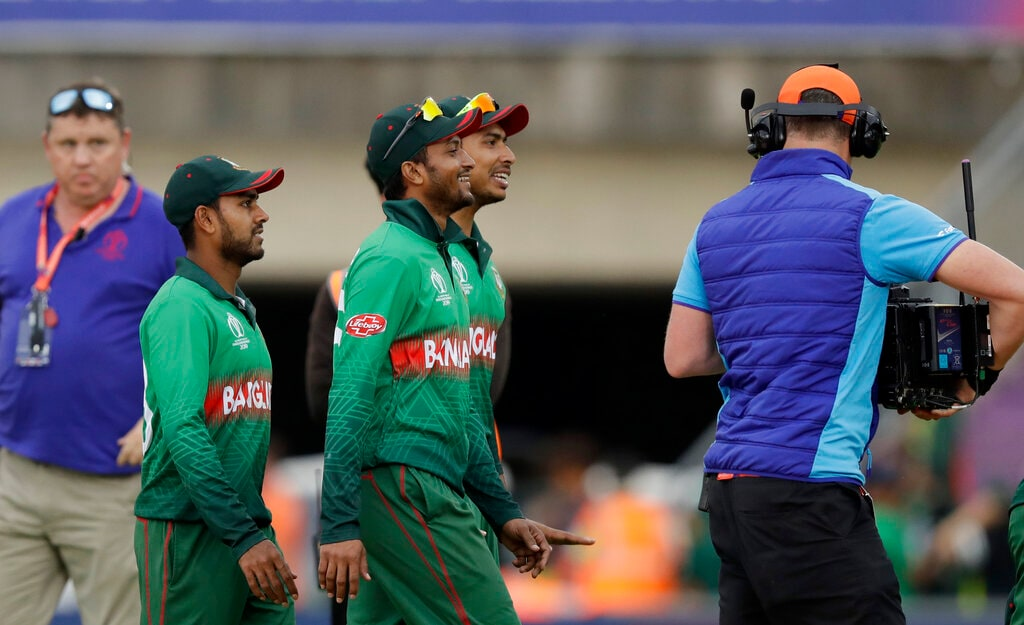 Man-of-the-match Bangladesh's Shakib Al Hasan, centre, walks off the field of play after they defeated Afghanistan by 62 runs in the Cricket World Cup match between Bangladesh and Afghanistan at the Hampshire Bowl in Southampton, England, Monday, June 24, 2019. (AP Photo/Matt Dunham)