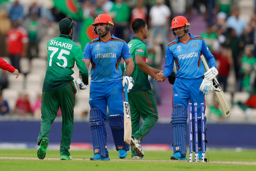 Man-of-the-match Bangladesh's Shakib Al Hasan, 75, shakes hands with Afghanistan's Samiullah Shinwari, second left, after they defeated Afghanistan by 62 runs in the Cricket World Cup match between Bangladesh and Afghanistan at the Hampshire Bowl in Southampton, England, Monday, June 24, 2019. (AP Photo/Matt Dunham)
