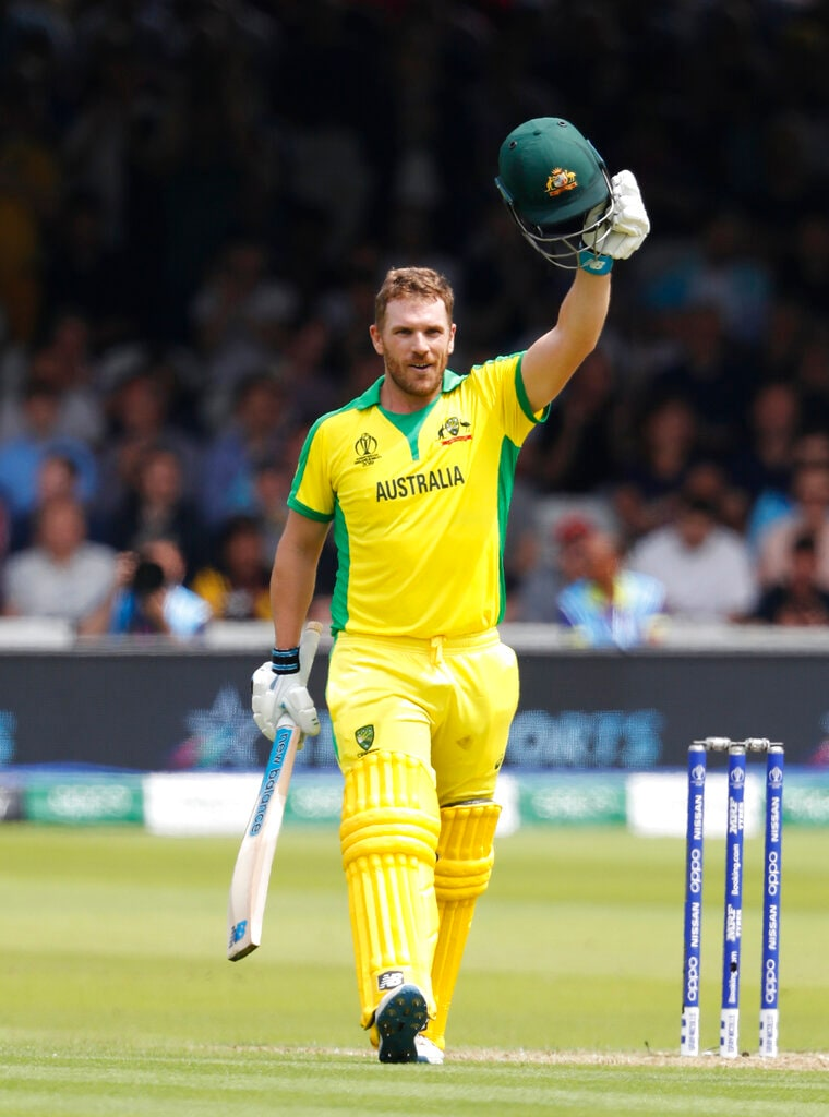 Australia's captain Aaron Finch celebrates getting 100 runs not out during their Cricket World Cup match between England and Australia at Lord's cricket ground in London, Tuesday, June 25, 2019. (AP Photo/Alastair Grant)