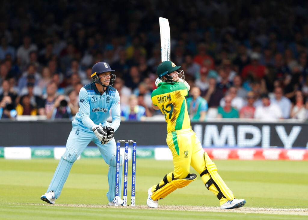Australia's Steve Smith hits runs off the bowling of England's Adil Rashid during their Cricket World Cup match between England and Australia at Lord's cricket ground in London, Tuesday, June 25, 2019. (AP Photo/Alastair Grant)