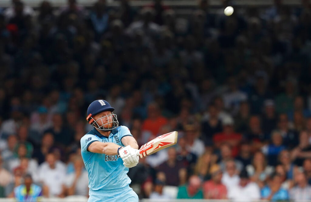 England's Jonny Bairstow skies his shot and is caught out by Australia's Pat Cummins off the bowling of Australia's Jason Behrendorff during their Cricket World Cup match between England and Australia at Lord's cricket ground in London, Tuesday, June 25, 2019. (AP Photo/Alastair Grant)