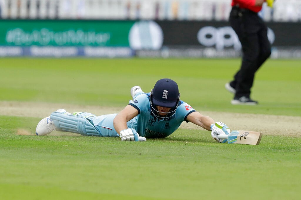 England's Jos Buttler slides in safely to avoid being run out during the Cricket World Cup match between England and Australia at Lord's cricket ground in London, Tuesday, June 25, 2019. (AP Photo/Matt Dunham)