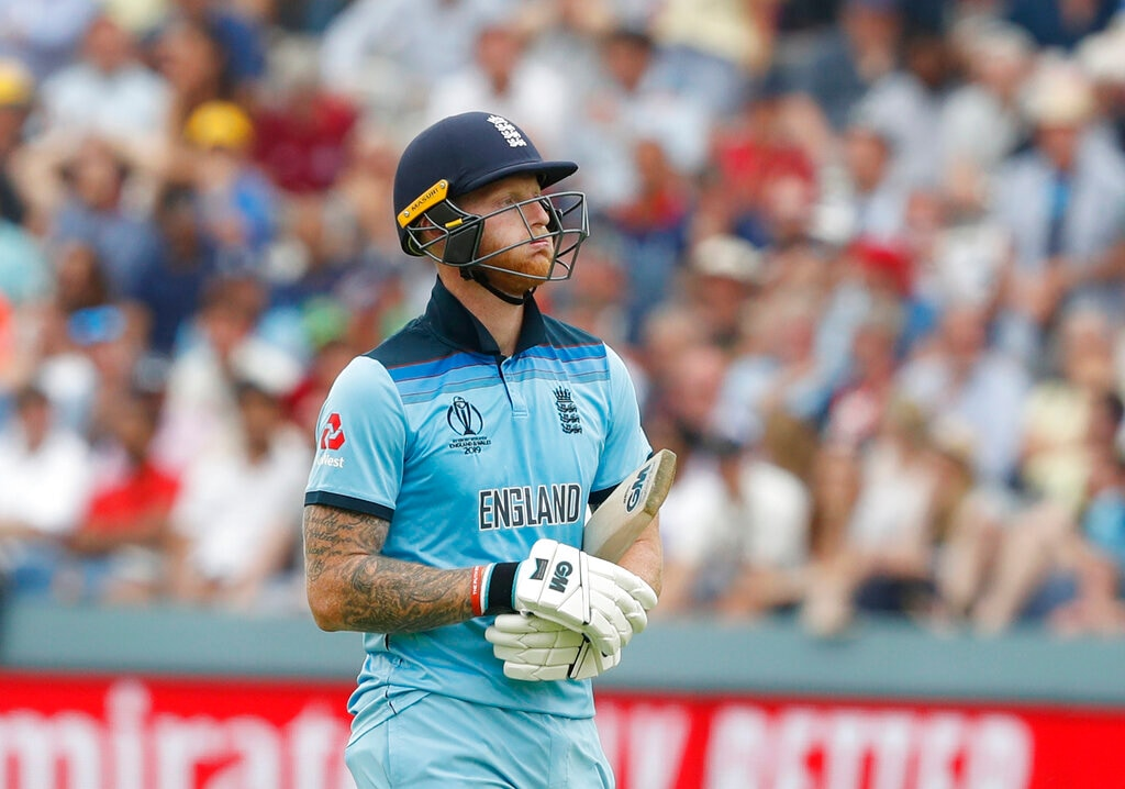 England's Ben Stokes walks off the pitch after being given out clean bowled by Australia's Mitchell Starc during the Cricket World Cup match between England and Australia at Lord's cricket ground in London, Tuesday, June 25, 2019. (AP Photo/Alastair Grant)