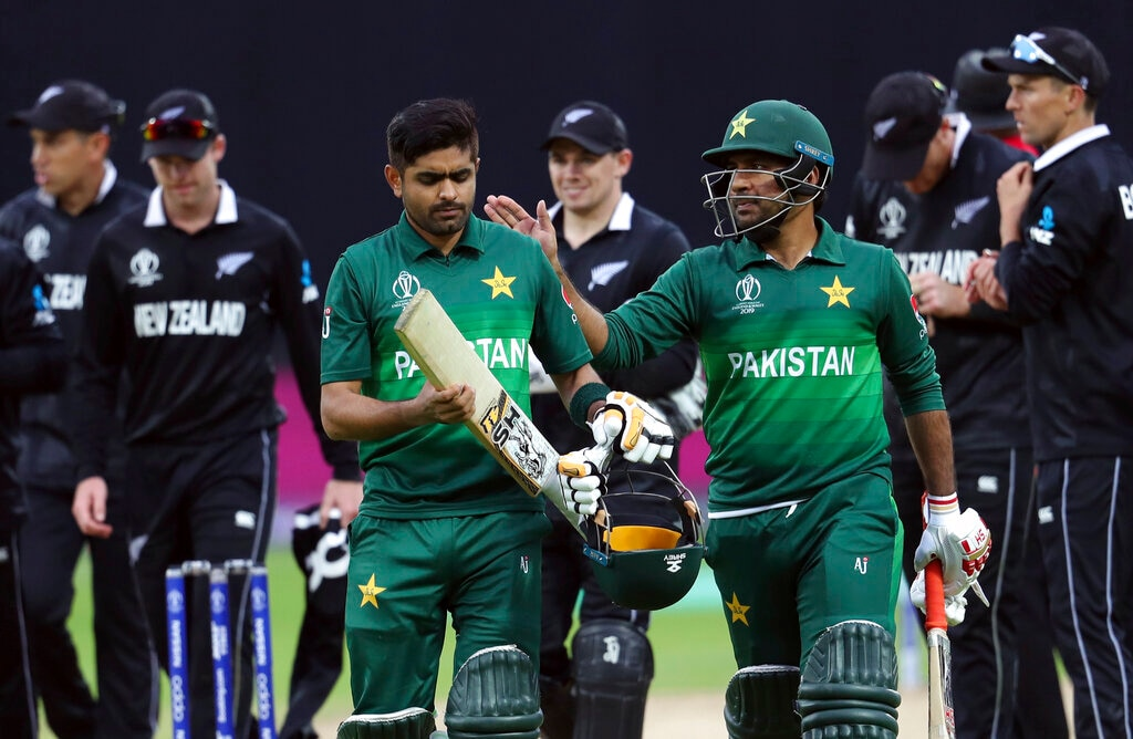 Pakistan's captain Sarfaraz Ahmed, right, pat on the shoulder teammate Babar Azam for scoring a century at the end of the Cricket World Cup match between New Zealand and Pakistan at the Edgbaston Stadium in Birmingham, England, Wednesday, June 26, 2019. Pakistan beat New Zealand by 6 wickets with 5 balls remaining. (AP Photo/Rui Vieira)
