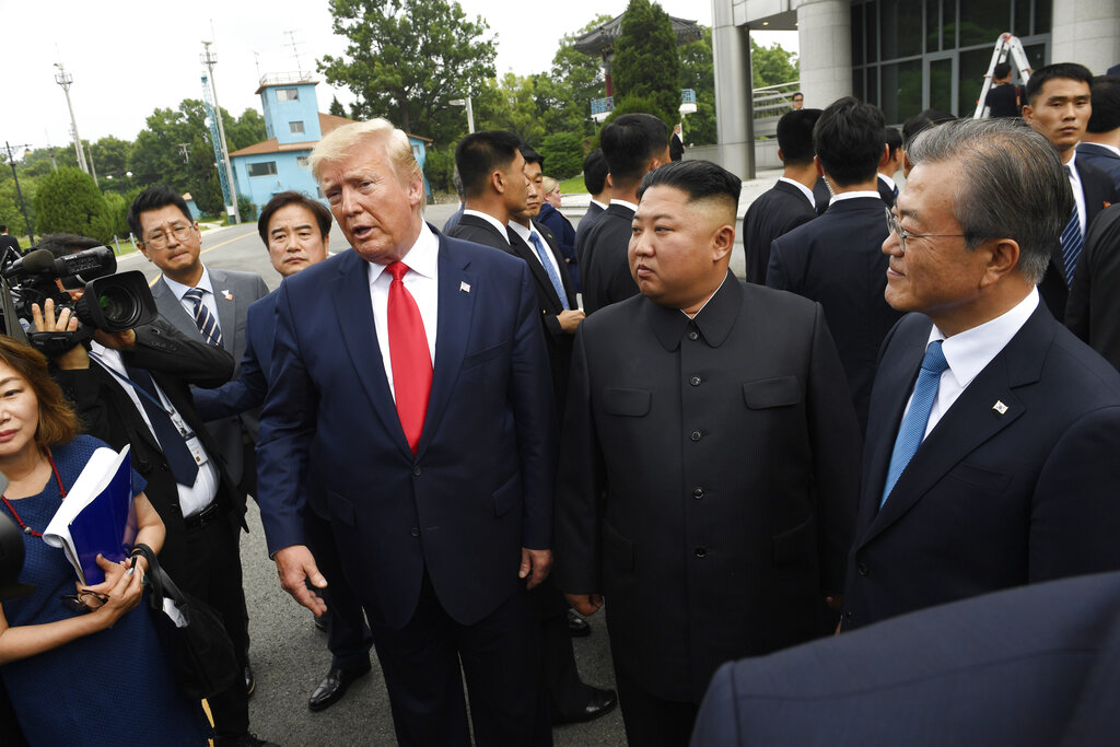 US President Donald Trump (left) meets with North Korean leader Kim Jong Un and South Korean President Moon Jae-in (right) at the border village of Panmunjom in the Demilitarized Zone, South Korea, on Sunday. (AP Photo/Susan Walsh)
