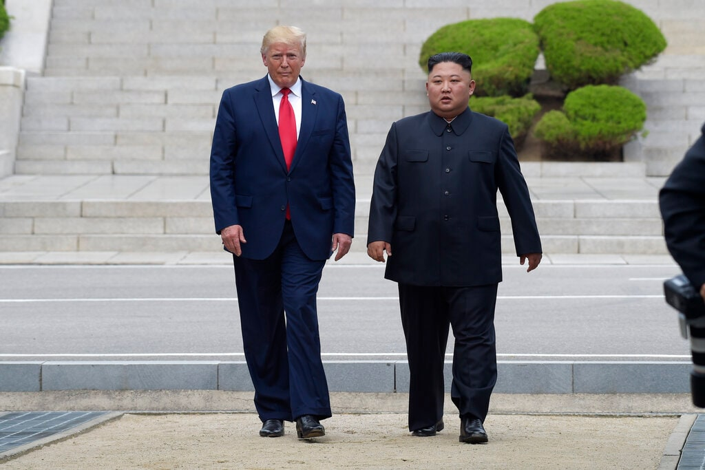 In a historic gesture, Trump and Kim walk on the North Korean side in the Demilitarized Zone at Panmunjom. (AP Photo/Susan Walsh)