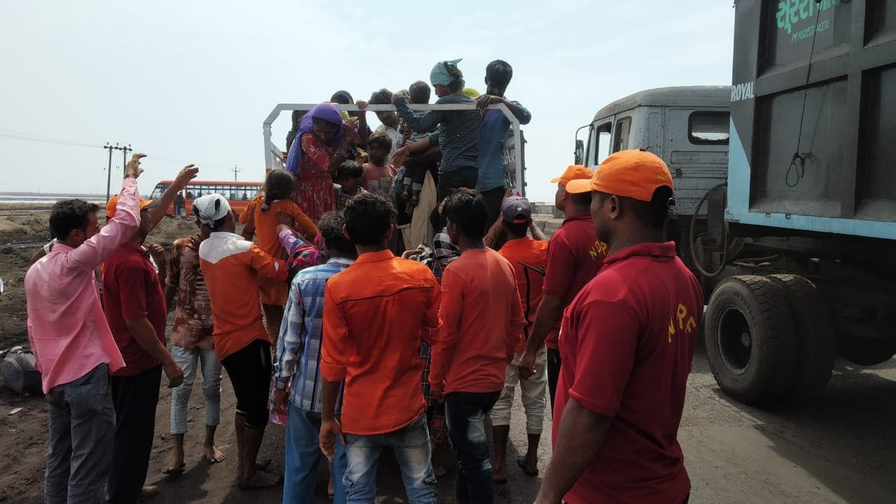 A Team of NDRF facilitating evacuation across the Porbandar-Diu-Veraval coastal expanse in the wake of Cyclone Vayu which is likely to hit the Gujarat coast on Thursday; on June 12, 2019. (Photo: IANS/PIB)