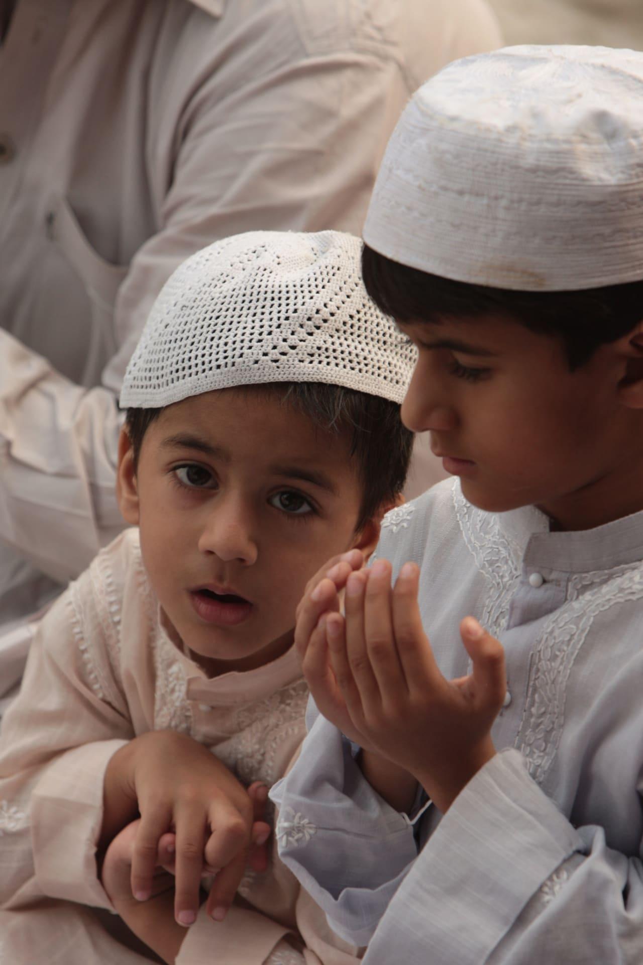 Children offering namaz at the Jama Masjid.