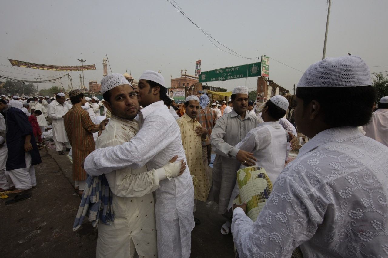 People wish each other 'Eid Mubarak' after the prayers.