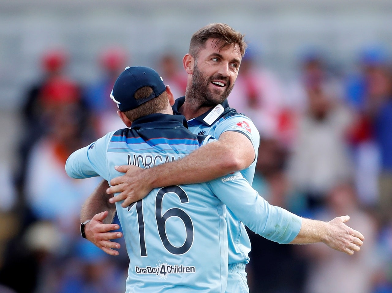 Cricket - ICC Cricket World Cup - England v India - Edgbaston, Birmingham, Britain - June 30, 2019 England's Liam Plunkett celebrates with Eoin Morgan after taking the wicket of India's Hardik Pandya Action Images via Reuters/Paul Childs