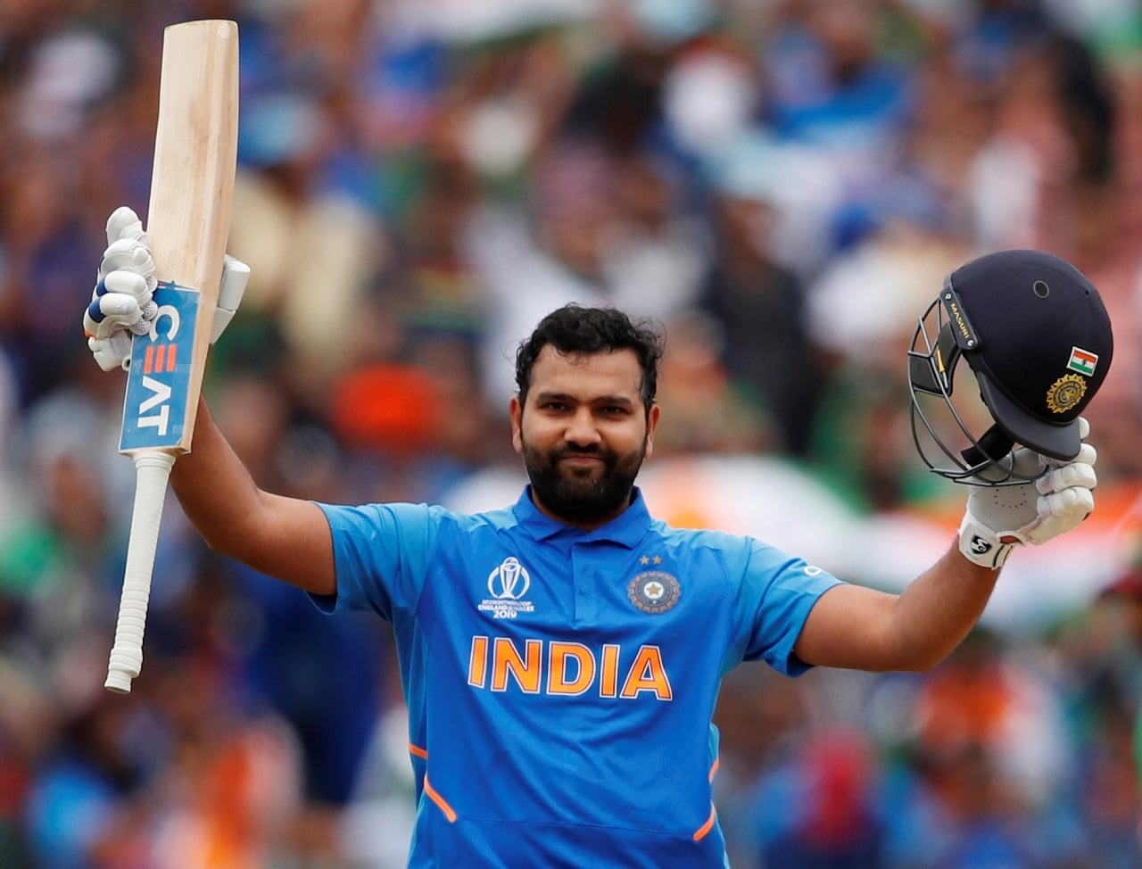 Cricket - ICC Cricket World Cup - Bangladesh v India - Edgbaston, Birmingham, Britain - July 2, 2019 India's Rohit Sharma celebrates his century Action Images via Reuters/Andrew Boyers