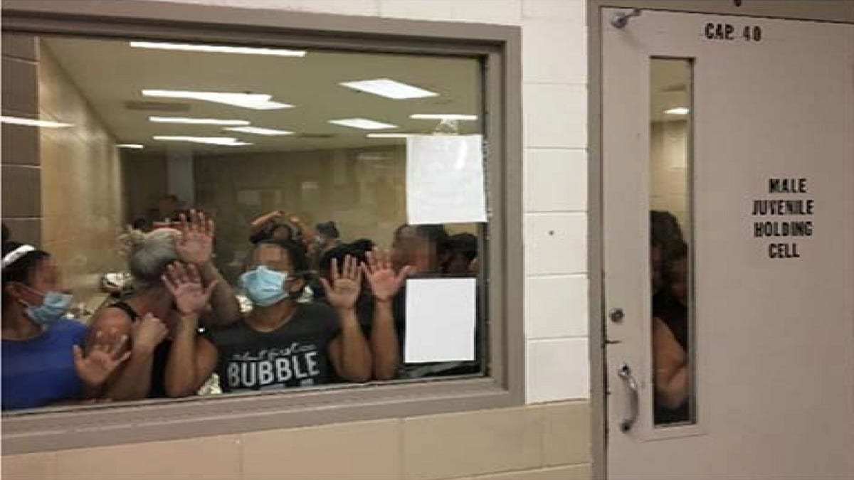 Some of a group of 51 adult females press against the window of a cell built to hold 40 male juveniles at Fort Brown Border Patrol station in a still image from video in Brownsville, Texas. Picture pixelated at the source. Office of Inspector General/DHS/Handout via REUTERS