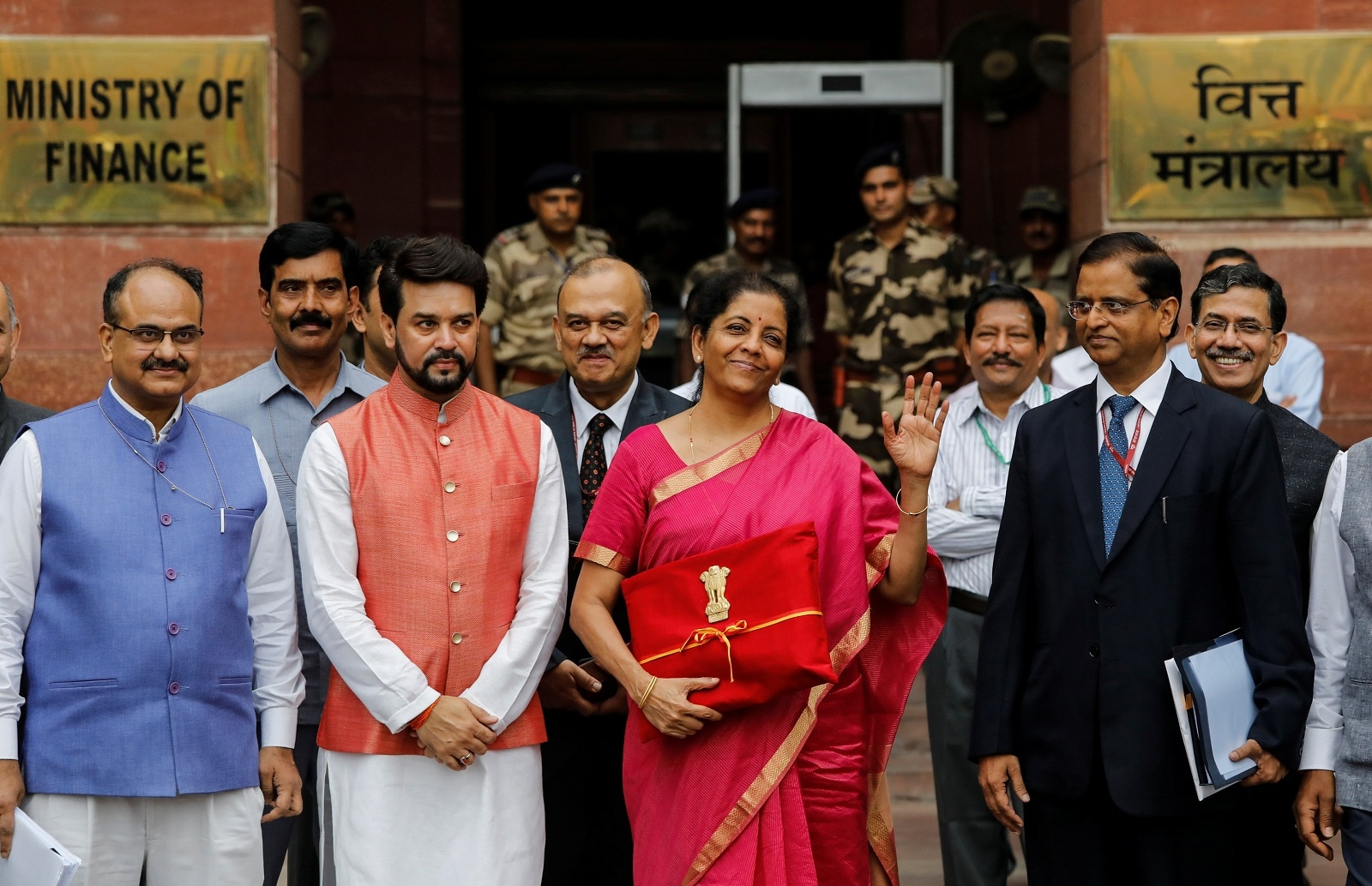 India's Finance Minister Nirmala Sitharaman (C) gestures during a photo opportunity as she leaves her office to present the federal budget in the parliament in New Delhi, July 5, 2019. The government has proposed to increase the minimum public shareholding to 35 percent from 25 percent. REUTERS/Anushree Fadnavis