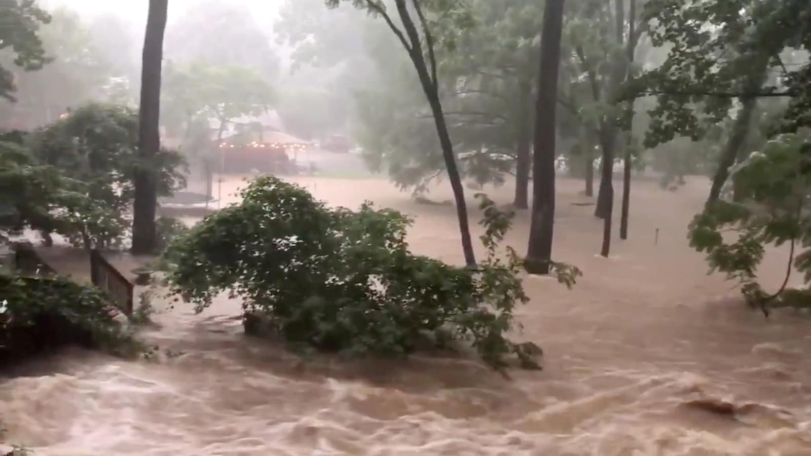 Flood waters are pictured in North Arlington, Virginia, US, July 8, 2019 in this picture grab obtained from social media video. Twitter/Hope Hodge Seck/@hopeseck/via REUTERS