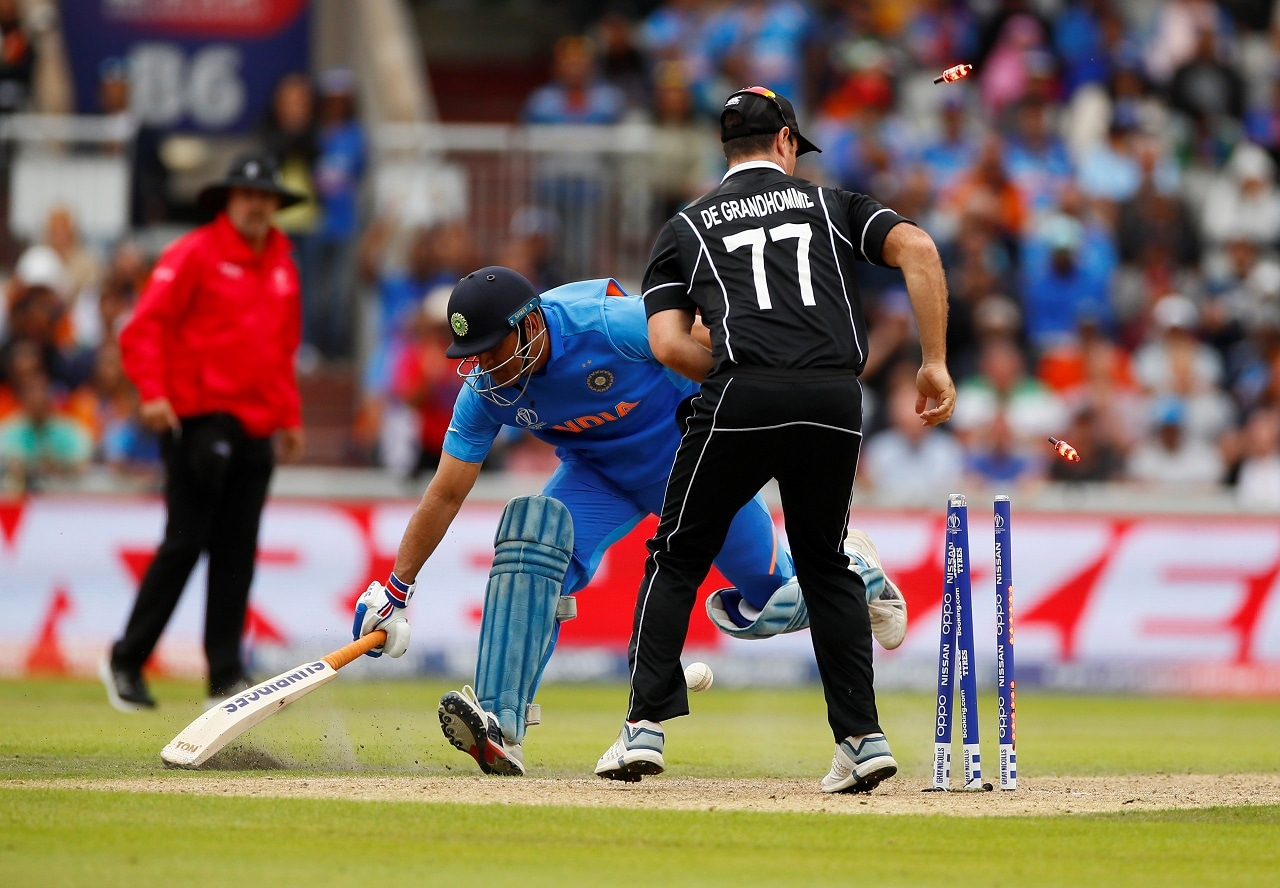 Cricket - ICC Cricket World Cup Semi Final - India v New Zealand - Old Trafford, Manchester, Britain - July 10, 2019 India's MS Dhoni loses his wicket Action Images via Reuters/Jason Cairnduff