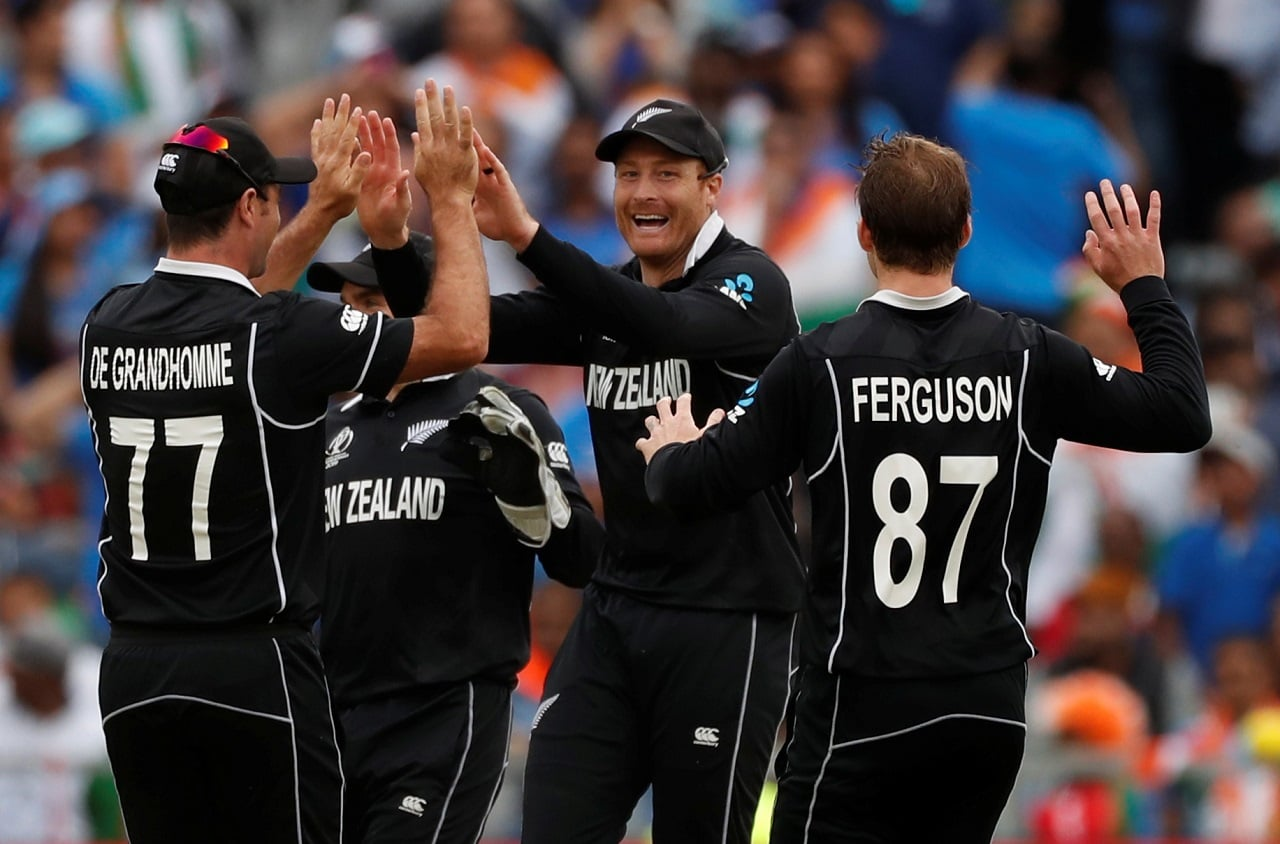 Cricket - ICC Cricket World Cup Semi Final - India v New Zealand - Old Trafford, Manchester, Britain - July 10, 2019 New Zealand's Martin Guptill celebrates with team mates after taking the wicket of India's MS Dhoni Action Images via Reuters/Lee Smith