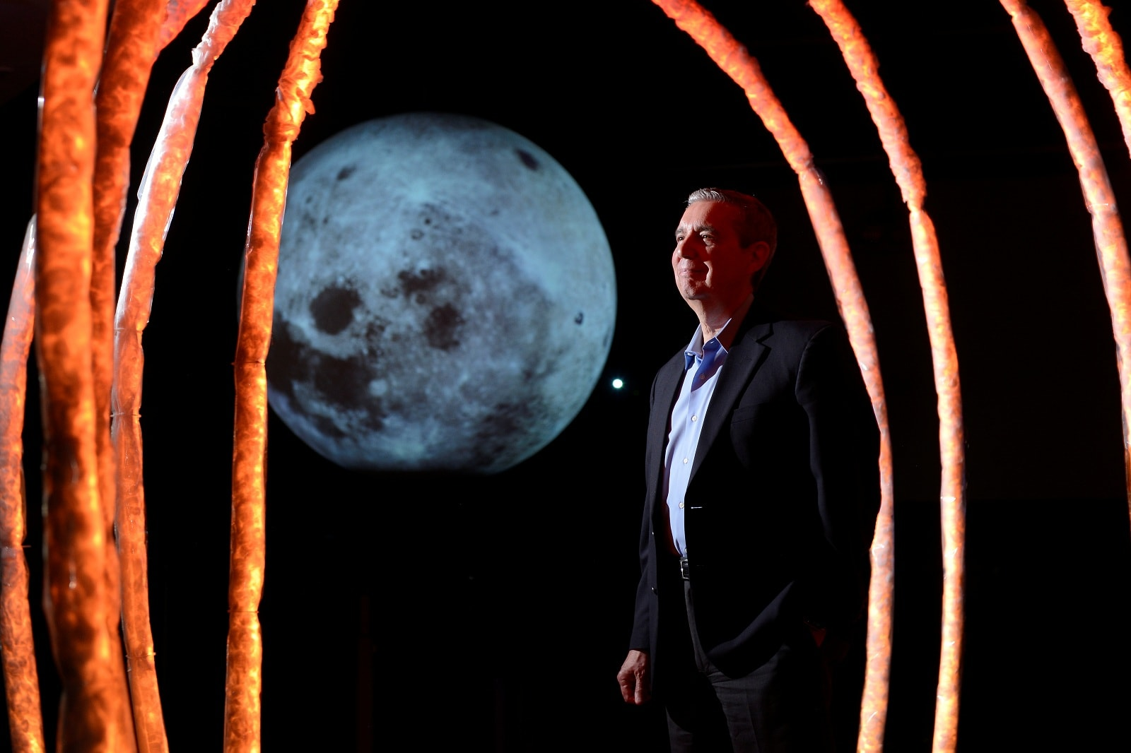 Jack Burns, who is working with NASA to put telescopes on the moon by using telerobotic technology, stands for a portrait at the Fiske Planetarium in Boulder, Colorado, US, June 24, 2019. REUTERS/Michael Ciaglo