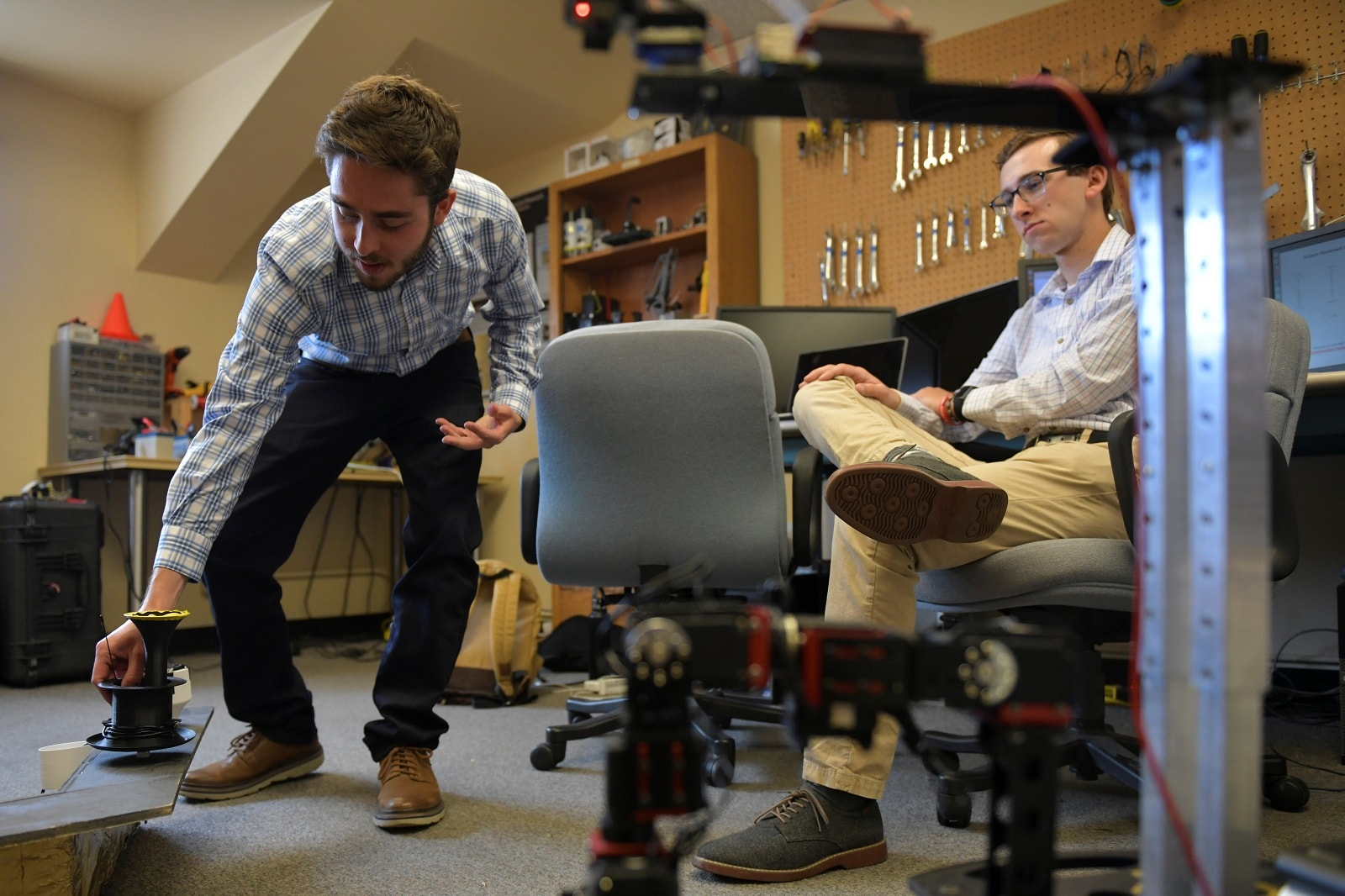 University of Colorado Boulder graduate researcher Ben Mellinkoff (L) sets up an experiment for Armstrong, an assembly robot that utilizes low latency telerobotics that would allow close to real-time video monitoring of operations on the far side of the moon, at a lab in Boulder, Colorado, US, June 24, 2019. REUTERS/Michael Ciaglo