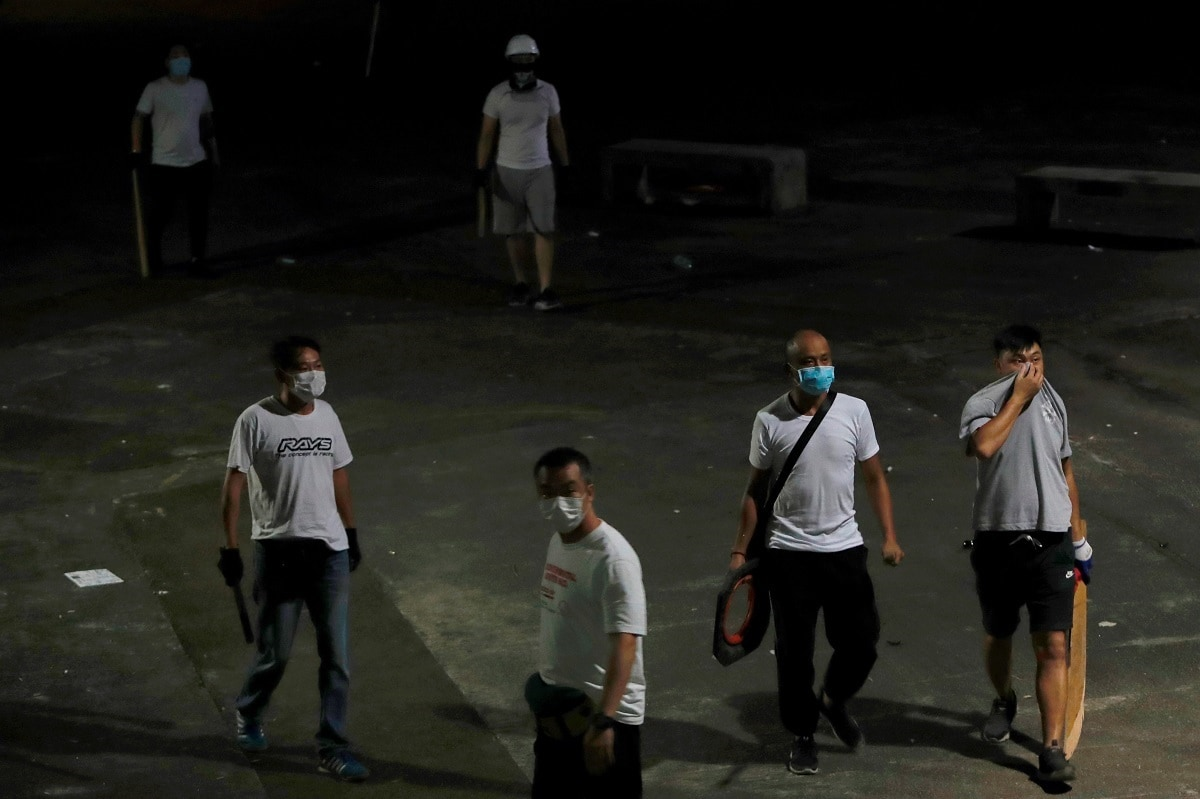 Hong Kong police faced criticism on Monday for an apparent failure to protect anti-government protesters and passersby from attack by what opposition politicians suspected were gang members at a train station on the weekend. (REUTERS/Tyrone Siu)