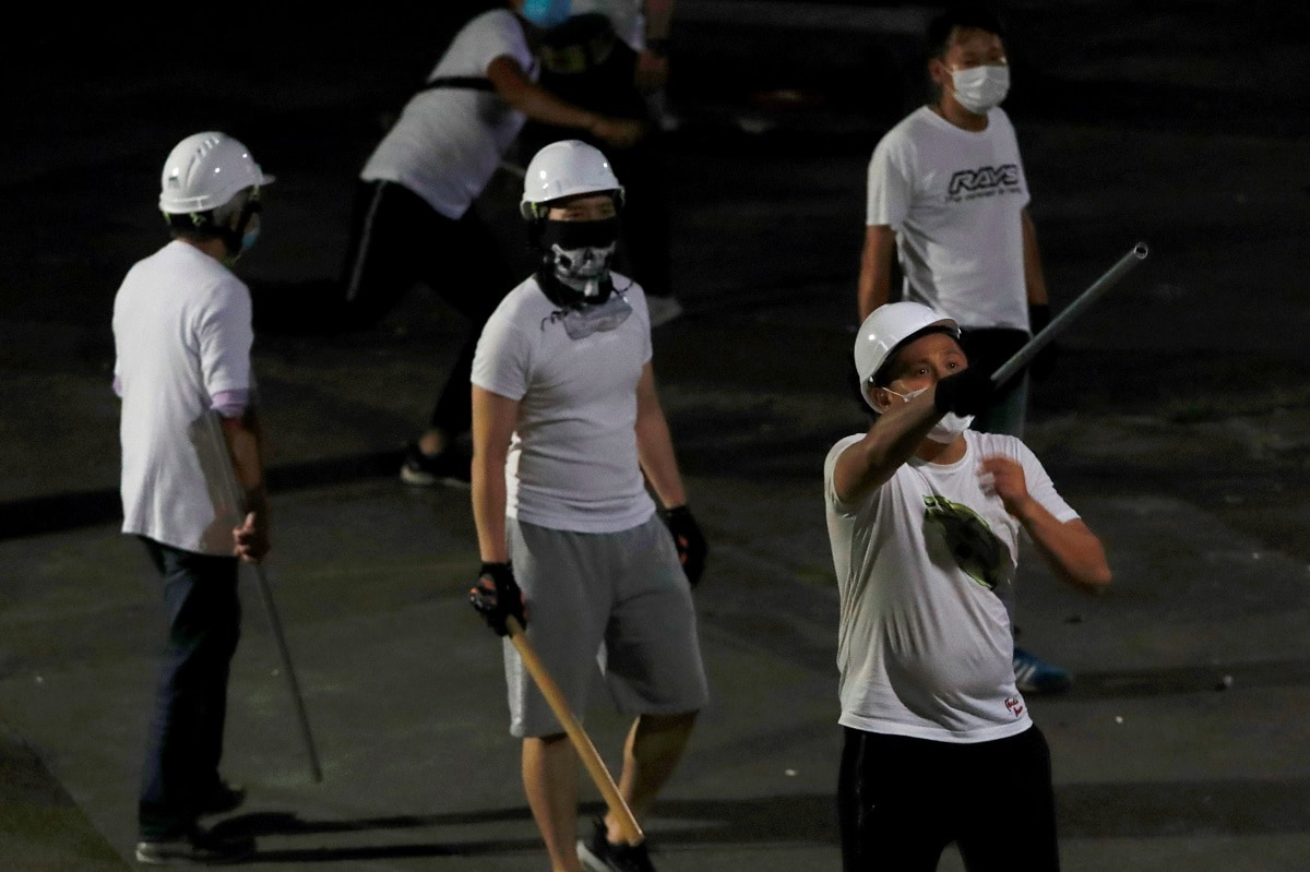 The attack on Sunday came during a night of escalating violence that opened new fronts in Hong Kong's widening political crisis over an extradition bill that could see people sent to China for trial. (REUTERS/Tyrone Siu)