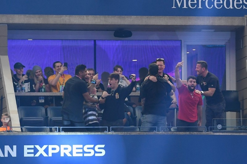 Fans of player Dubs celebrate after his victory in the third round of six at the Fortnite World Cup Finals e-sports event at Arthur Ashe Stadium. Mandatory Credit: Dennis Schneidler-USA TODAY Sports