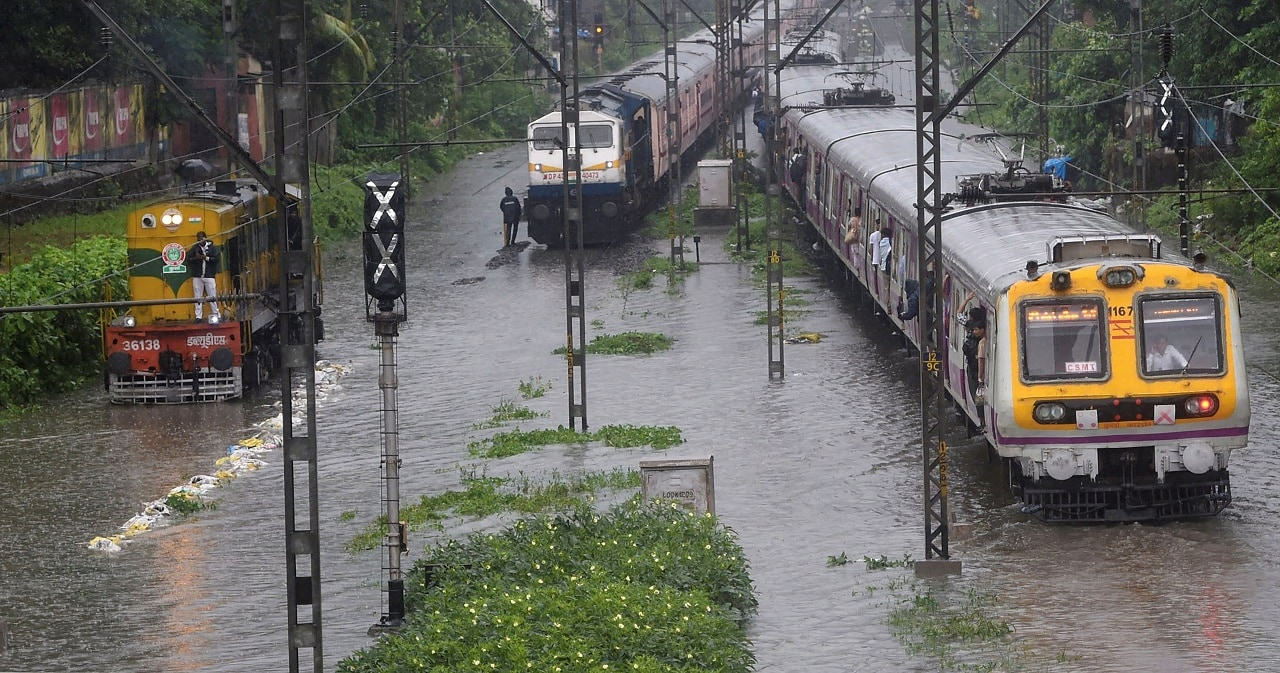 Mumbai: Suburban trains chug on water-logged tracks during heavy rains, in Mumbai, Monday, July 01, 2019. (PTI Photo/Shashank Parade)