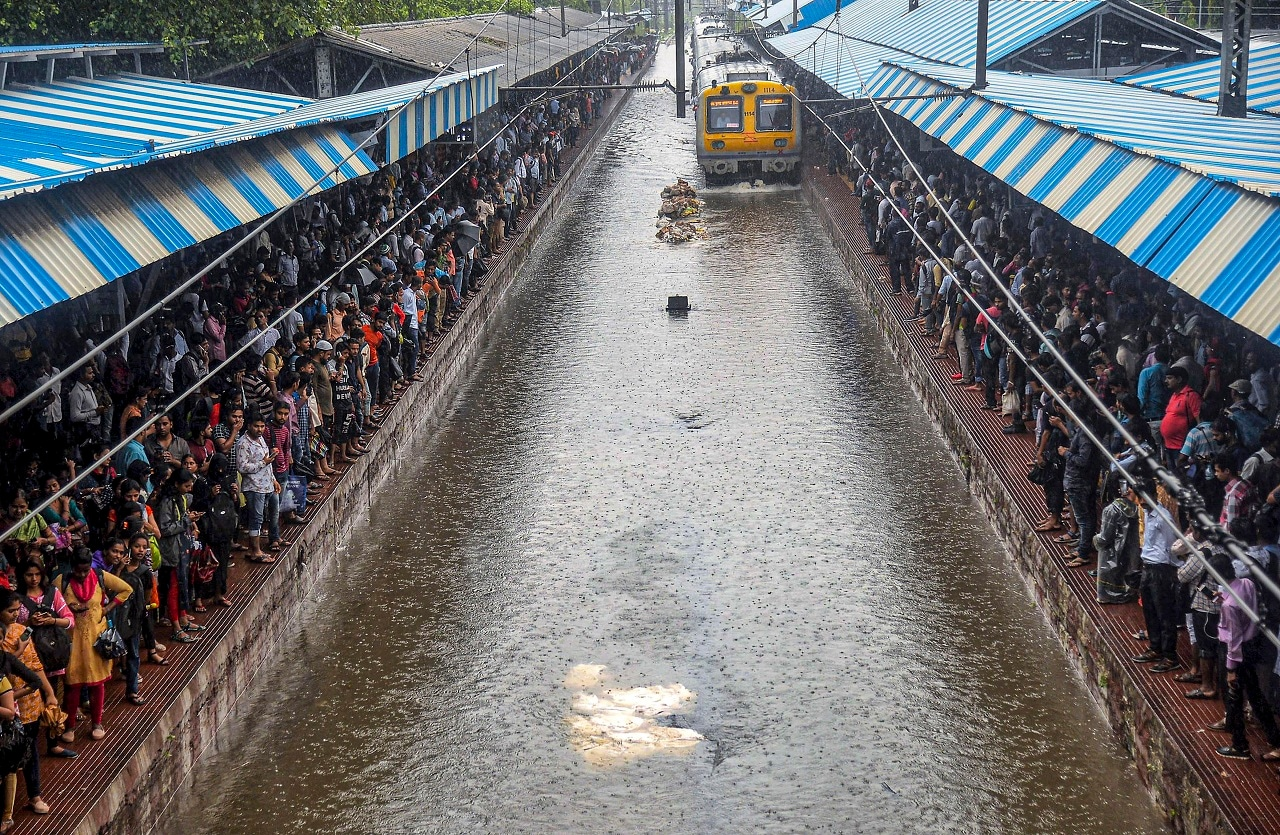 Mumbai: A local train chugs on water-logged tracks during heavy rains at Sion station, in Mumbai, Monday, July 01, 2019. (PTI Photo)