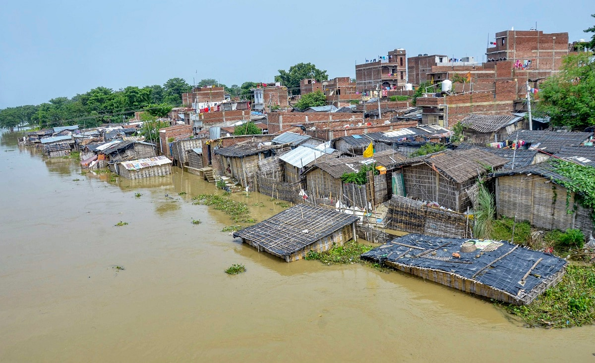 A flooded village following incessant monsoon rains, at Mushari in Muzaffarpur district. Heavy rains affected normal life across India, particularly in Assam and Bihar. (PTI Photo)