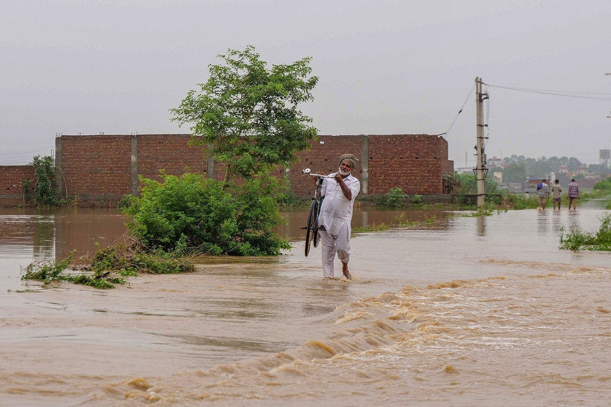 In north Bihar, the flood situation grew serious as water levels of rivers in the area continued to rise, with many like the Bagmati, Kamala and Mahananda crossing the danger mark at various places, and the Kosi and Gandak also brimming. (PTI Photo)