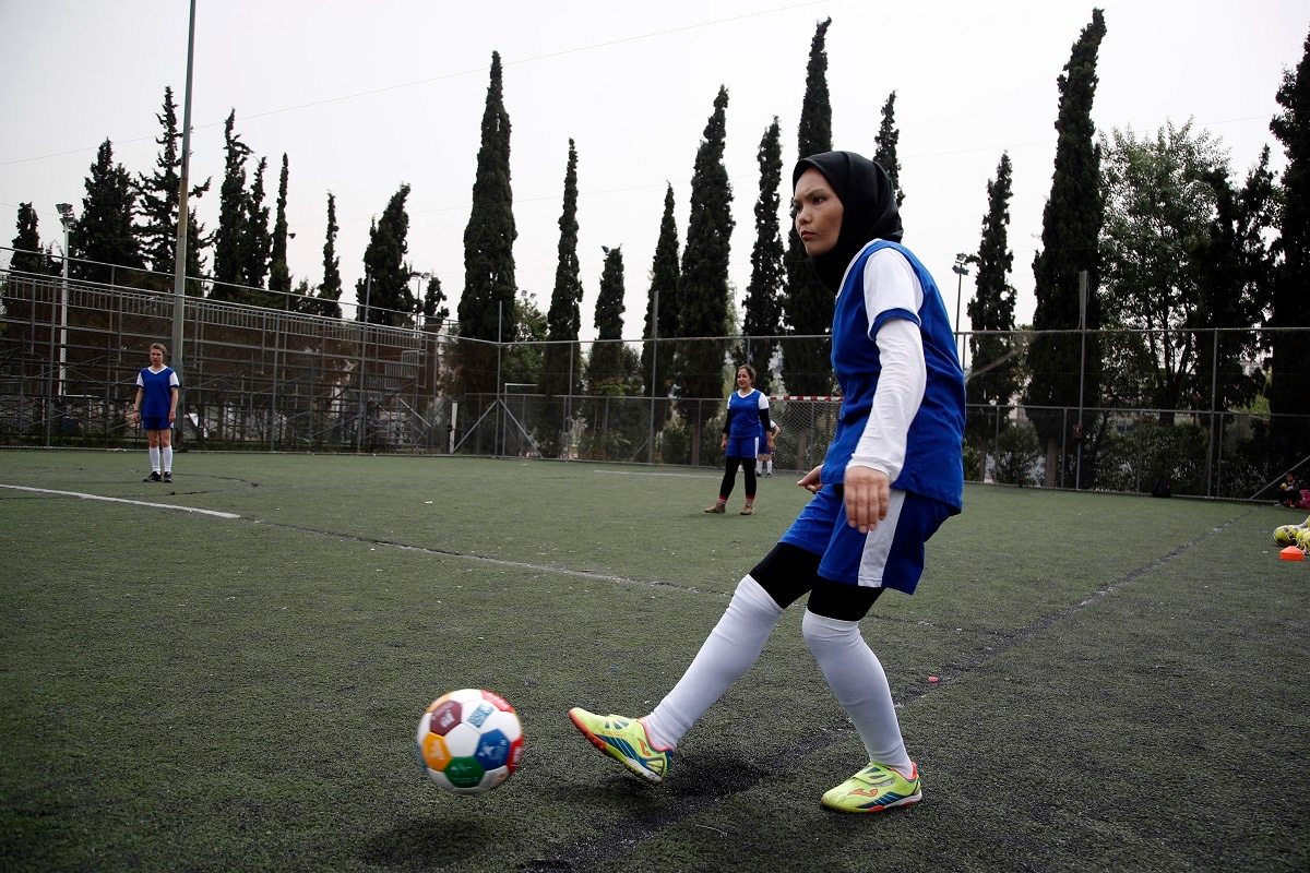 Fatima from Afghanistan passes the ball during a training session of Hestia FC Women's Refugee Soccer team in Athens.  (AP Photo/Thanassis Stavrakis)
