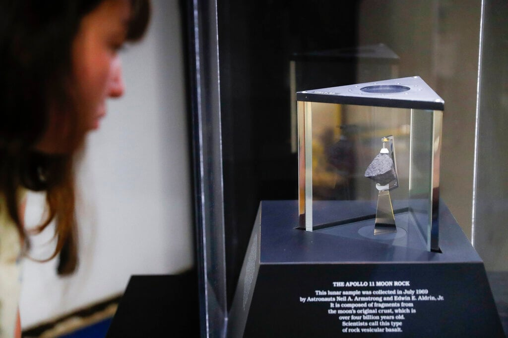 A moon rock is displayed within a glass case at the Armstrong Air & Space Museum, Wednesday, June 26, 2019, in Wapakoneta, Ohio. (AP Photo/John Minchillo)