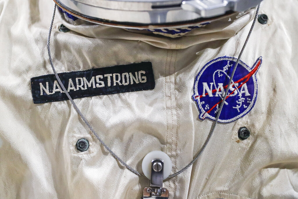 Patches adorn the spacesuit worm by astronaut Neil Armstrong for the Gemini VIII mission at the Armstrong Air & Space Museum, Wednesday, June 26, 2019, in Wapakoneta, Ohio. (AP Photo/John Minchillo)