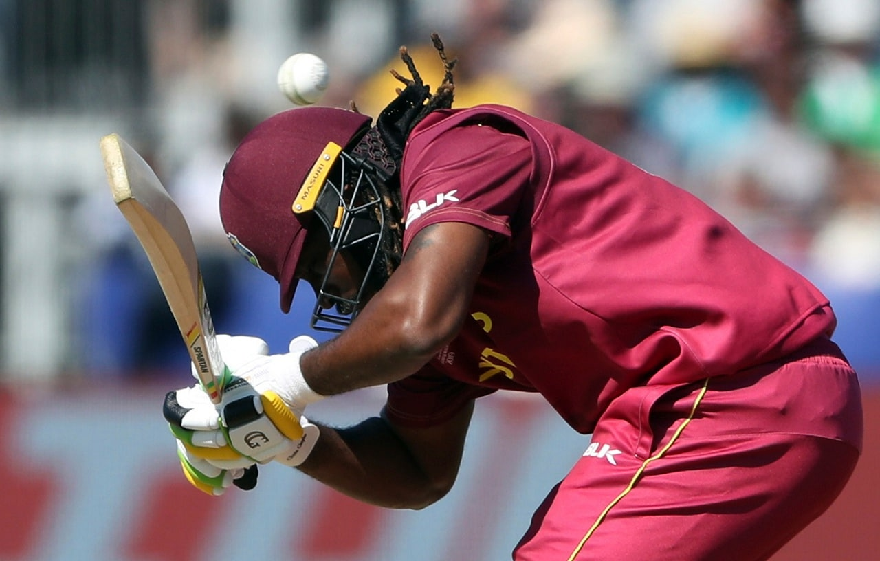 West Indies' batsman Chris Gayle bends to avoid a rising delivery from Sri Lanka's bowler Lasith Malinga during the Cricket World Cup match between Sri Lanka and the West Indies at the Riverside Ground in Chester-le-Street, England, Monday, July 1, 2019. (AP Photo/Scott Heppell)