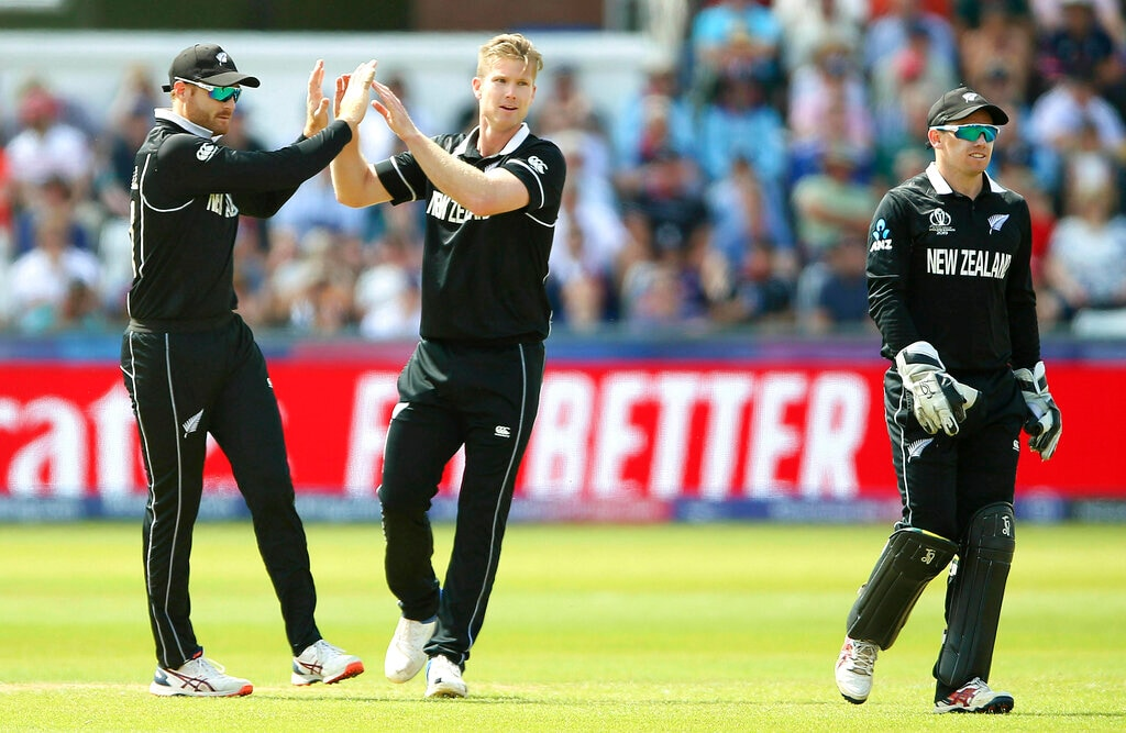 New Zealand's James Neesham, center, celebrates taking the wicket of England's Jason Roy during the Cricket World Cup match between New Zealand and England in Chester-le-Street, England, Wednesday, July 3, 2019. (Nigel French/PA via AP)