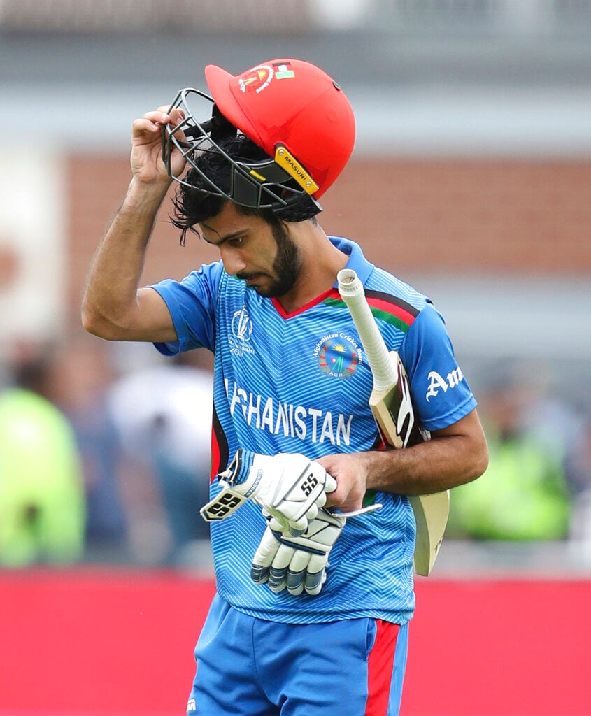 Afghanistan's Ikram Ali leaves the field after being dismissed by West Indies' Chris Gayle during the Cricket World Cup match between Afghanistan and West Indies at Headingley in Leeds, England, Thursday, July 4, 2019. (AP Photo/Rui Vieira)