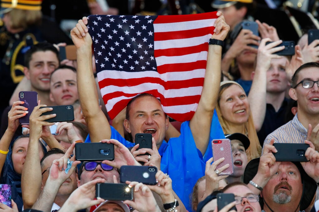 Audience members celebrate during an Independence Day celebration in front of the Lincoln Memorial, Thursday, July 4, 2019, in Washington. (AP Photo/Alex Brandon)