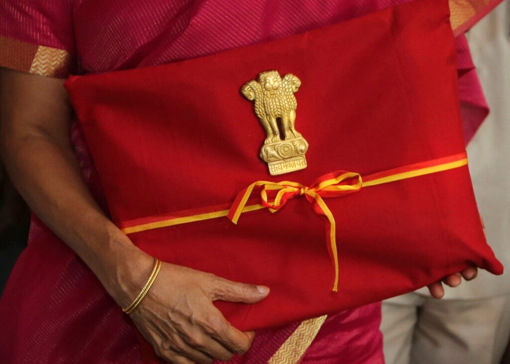 Finance minister Nirmala Sitharaman carries annual federal budget for the year 2019-20 to be presented at the parliament house in New Delhi, India, Friday, July 5, 2019. Sitharaman carried a traditional <em>