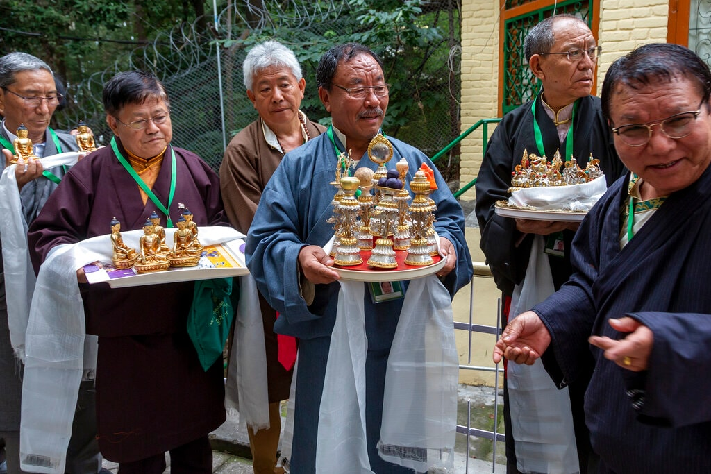 Former employees of the Central Tibetan Administration wait to present their spiritual leader the Dalai Lama with ceremonial offerings at the Tsuglakhang temple in Dharamhsala, India, Friday, July 5, 2019. (AP Photo/Ashwini Bhatia)