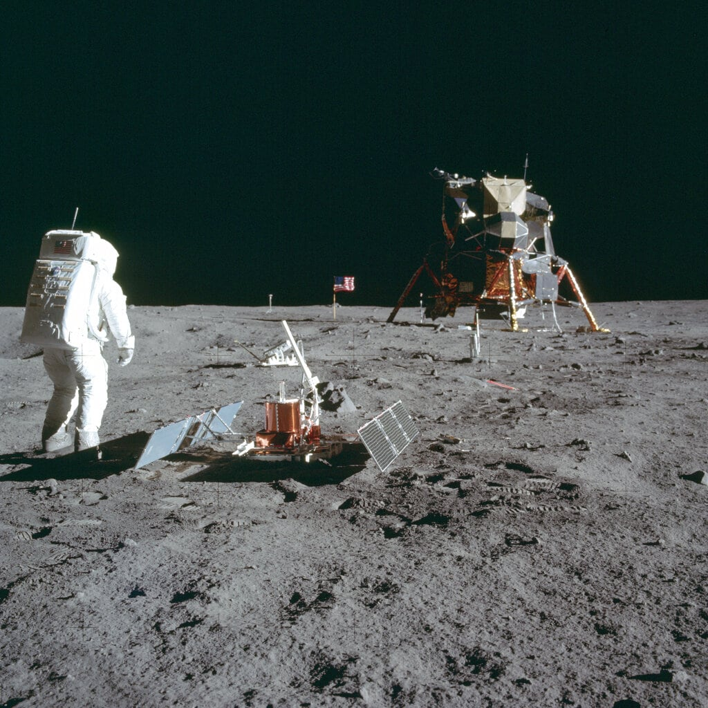 In this July 20, 1969 photo made available by NASA, astronaut Buzz Aldrin Jr. stands next to the Passive Seismic Experiment device on the surface of the moon during the Apollo 11 mission. (Neil Armstrong/NASA via AP)