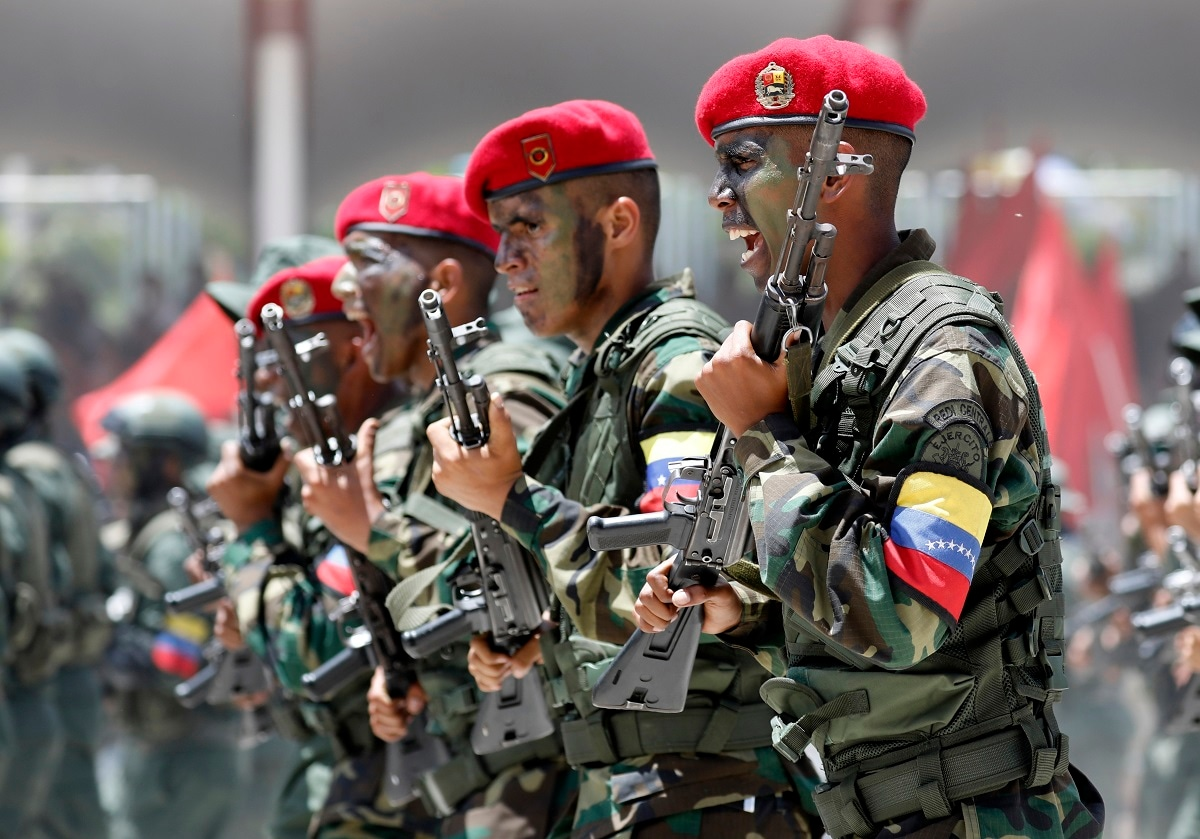 Soldiers march during a military parade marking Independence Day in Caracas. Venezuela is marking 208 years of its declaration of independence from Spain. (AP Photos/Ariana Cubillos)