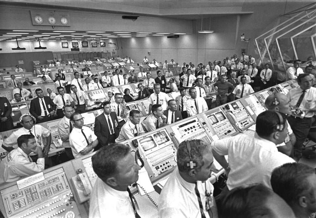 Launch controllers in the firing room at the Kennedy Space Center in Florida during the Apollo 11 mission to the moon. In the third row from foreground at center is JoAnn Morgan, the first female launch controller.