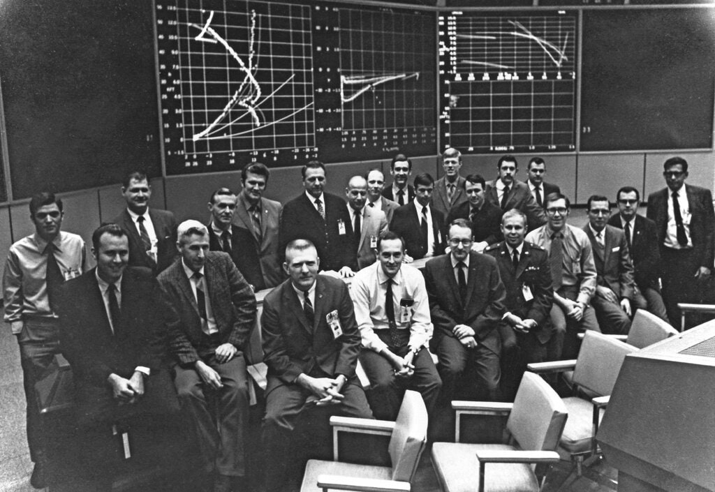 NASA shows Flight Activities Officer Spencer Gardner, first row fourth from right, with members of the Apollo 11 White Team, handling descent and landing, in the Mission Operation Control Room in Houston, shortly after the mission. Barely 26, Gardner was one of the youngest flight controllers on duty when the Eagle settled onto the Sea of Tranquility with Neil Armstrong and Buzz Aldrin on July 20, 1969. (NASA via AP)