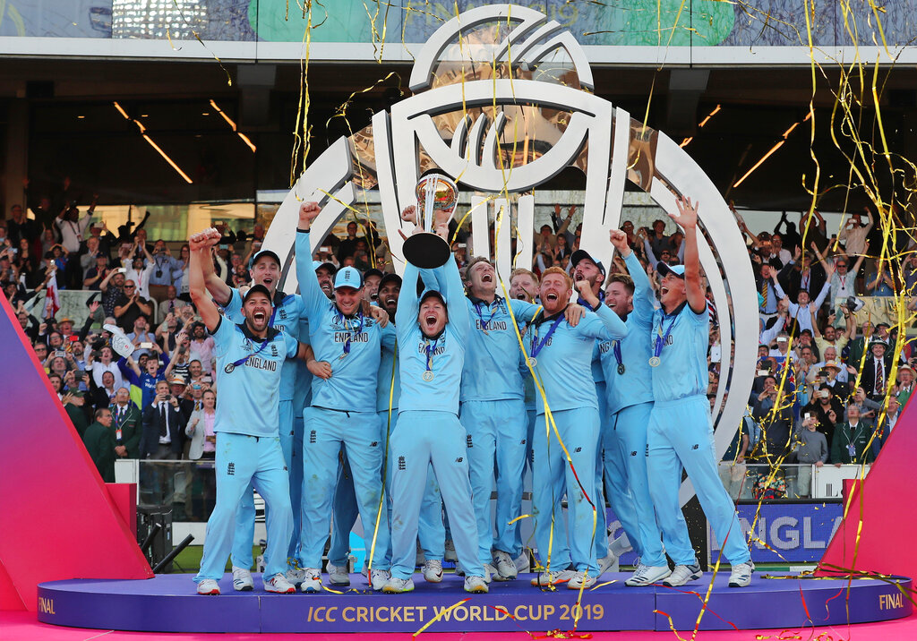England's captain Eoin Morgan lifts the trophy after winning the Cricket World Cup final match between England and New Zealand at Lord's cricket ground in London, England, Sunday, July 14, 2019. England won the Cricket World Cup for the first time in extraordinary circumstances, beating New Zealand by a tiebreaker of boundaries scored after the match was tied after regulation play and then the first Super Over in the tournament's history. (AP Photo/Aijaz Rahi)