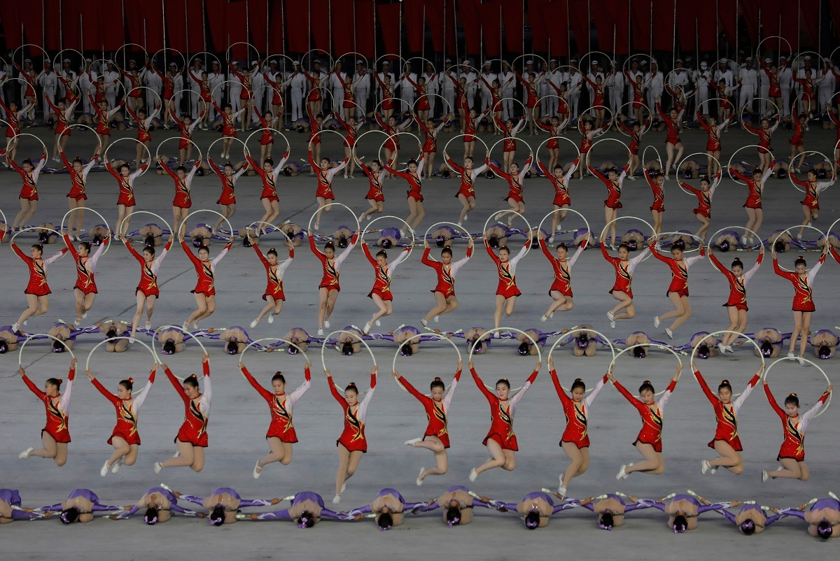 North Koreans perform during a mass game performance of
