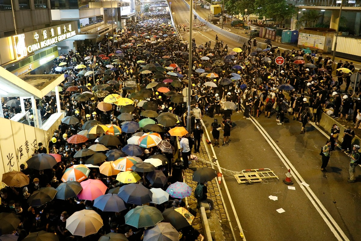 Protesters in Hong Kong pressed on Sunday past the designated end point for a march in which tens of thousands repeated demands for direct elections in the Chinese territory and an independent investigation into police tactics used in previous demonstrations. (AP Photo/Vincent Yu)