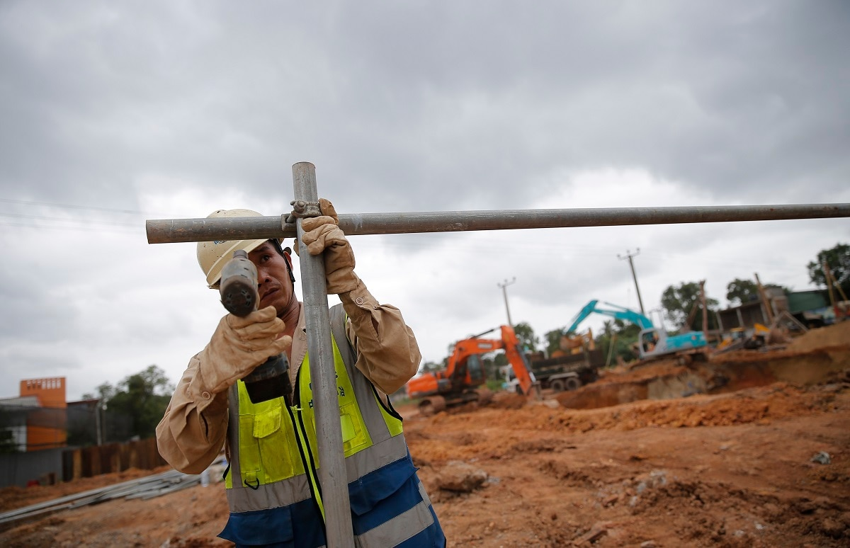 A Chinese labourer fixes iron pipes at a Chinese invested construction site in Colombo. The blasts have seriously affected the inflow of foreign investment into the country. (AP Photo/Eranga Jayawardena)