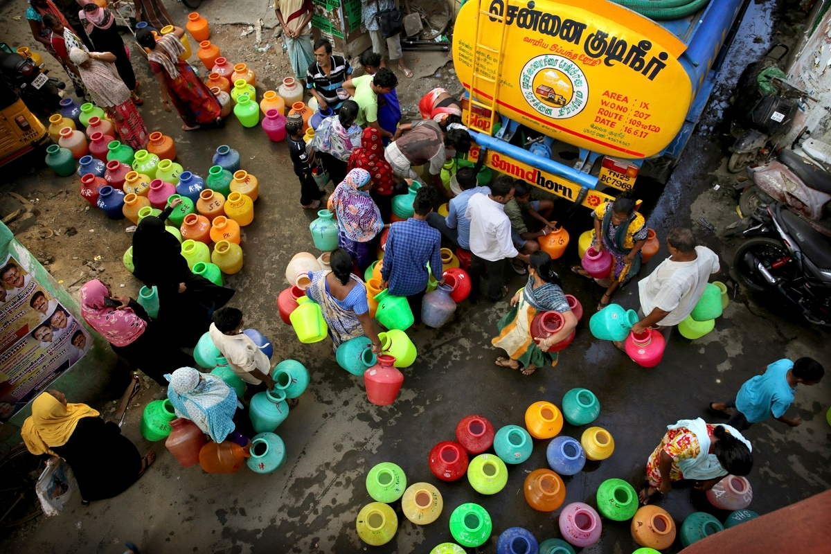 Residents fill drinking water from a truck in Chennai. A 50-tank train carries two and a half million litres of drinking water to the city daily. (AP Photo/Manish Swarup)