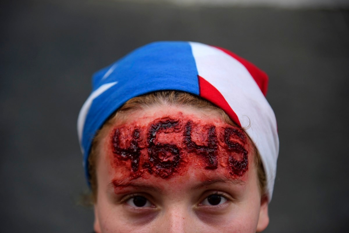 Nicole Diaz wears special effects make-up with Hurricane Maria's death toll number written on her forehead, while protesting against Governor Ricardo Rossello, in San Juan, Puerto Rico.  (AP Photo/Carlos Giusti)