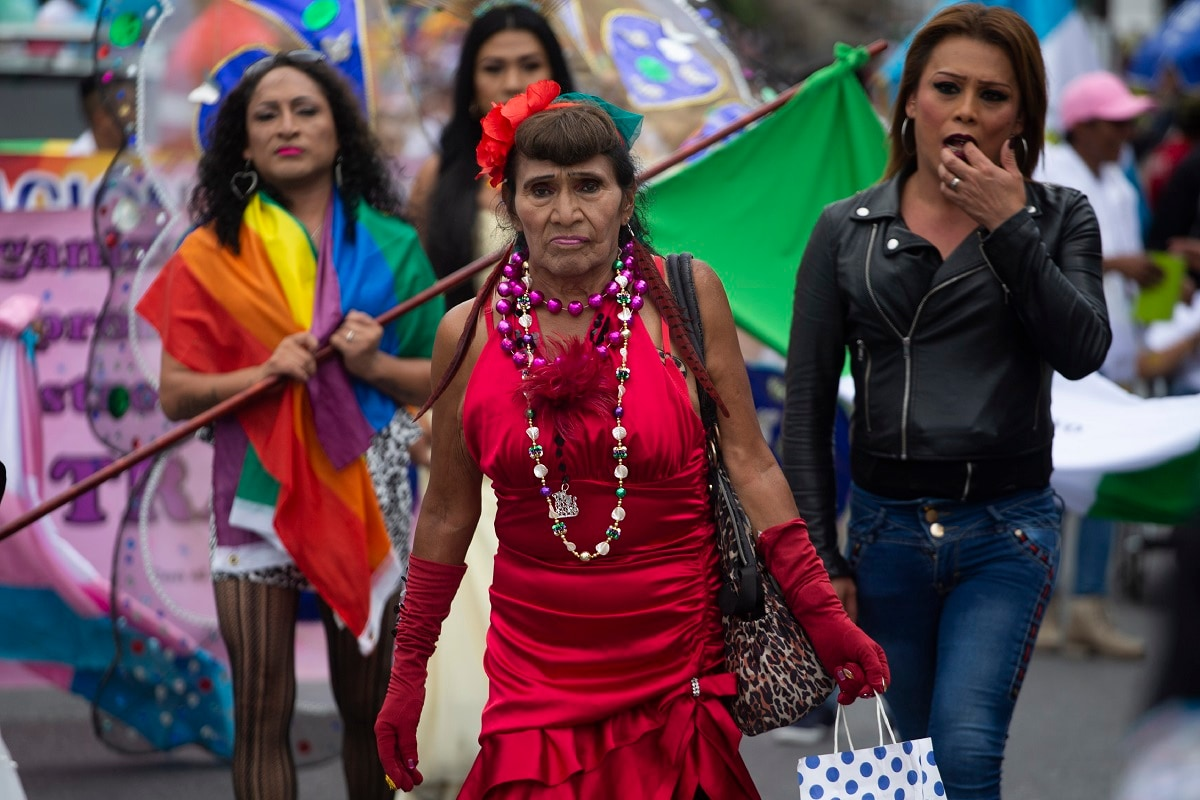 Revellers take part in the annual Gay Pride parade in Guatemala City's historic centre. (AP Photo/Moises Castillo)